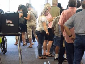 Voters waited in long lines at the polling place in Daskalos Plaza to vote in New Mexicos primary election, June 5, 2018, in Albuquerque, N.M.