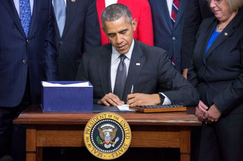 President Barack Obama signs the Every Student Succeeds Act, Dec. 10, 2015, in Washington, DC.
