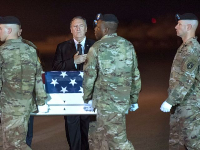 PHOTO: An Army carry team moves a transfer case containing the remains of Sgt. 1st Class Elis Barreto Ortiz, 34, from Morovis, Puerto Rico, past Secretary of State Mike Pompeo, Sept. 7, 2019.
