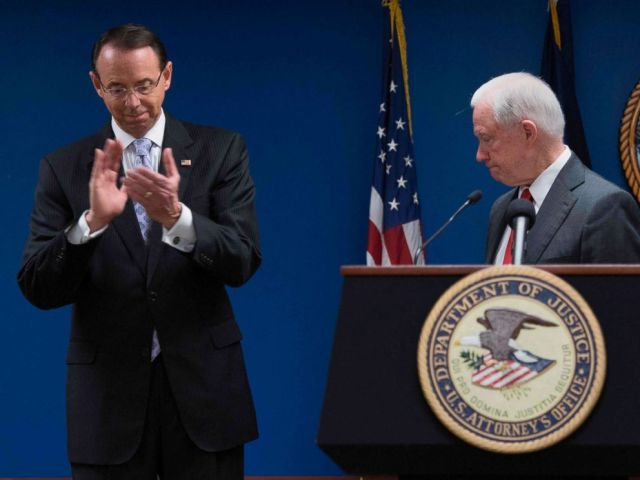 PHOTO: Deputy Attorney General Rod Rosenstein applauds after Attorney General Jeff Sessions, right, made an announcement on efforts to reduce transitional crime during a press conference at the U.S. Attorneys Office in Washington, Oct, 15, 2018.