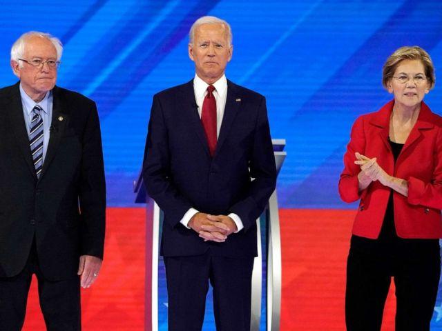 PHOTO: Senator Bernie Sanders joins former Vice President Joe Biden and Senator Elizabeth Warren onstage before the start at the 2020 Democratic U.S. presidential debate in Houston, Sept.12, 2019.