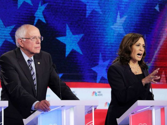 PHOTO: Bernie Sanders and Kamala Harris participate in the second night of the first 2020 democratic presidential debate at the Adrienne Arsht Center for the Performing Arts in Miami, June 27, 2019.