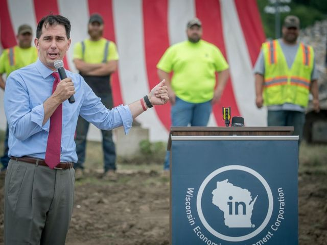 PHOTO: Wisconsin Governor Scott Walker announces a $500,000 state grant to support the demolition project of the long-dormant St. Croix Meadows dog racing track during a press conference at the site in Hudson, Wis, July 3, 2018.