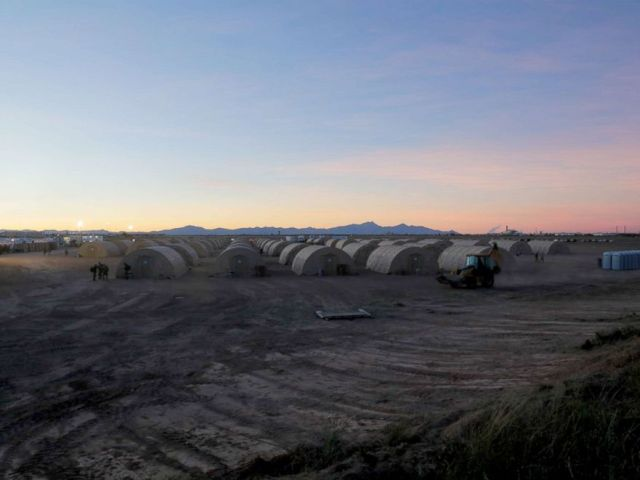 PHOTO: The sun sets in a tent city where soldiers support the US Customs and Border Protection Agency at Davis-Monthan Air Force Base, Arizona on November 4, 2018.