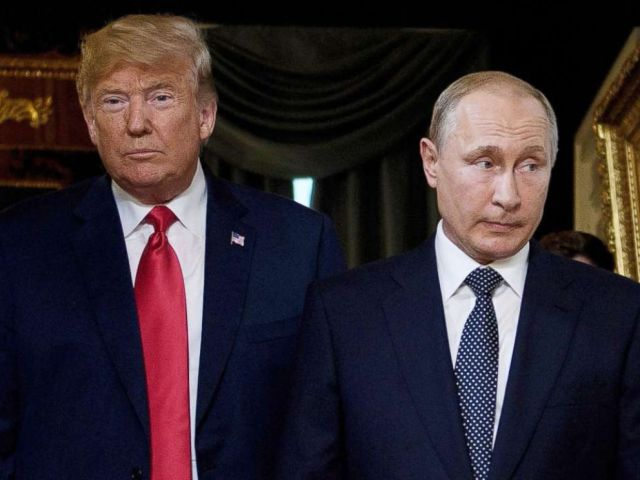 PHOTO: President Donald Trump (L) and Russian President Vladimir Putin arrive for a meeting in Helsinki, July 16, 2018.