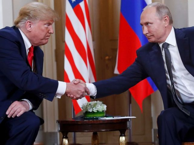 PHOTO: Donald Trump, left, and Vladimir Putin shake hands at the beginning of a meeting at the Presidential Palace in Helsinki, Finland.