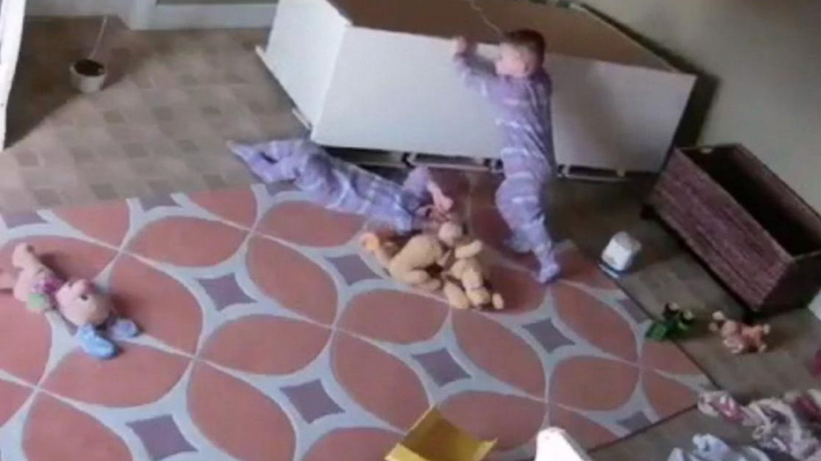 2 year old boy rescues twin brother from fallen dresser