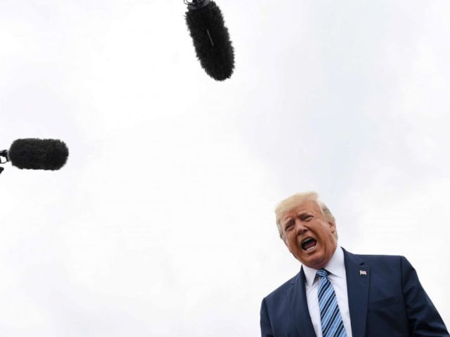 PHOTO: President Donald Trump talks to the media before boarding Air Force One at Morristown Municipal Airport in Morristown, N.J., Aug. 13, 2019.