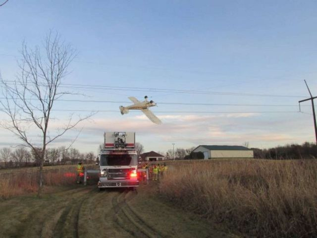 PHOTO: The pilot of a small plane was rescued after it crashed into a power line in Louisville Township, Minnesota.