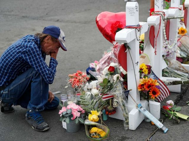 PHOTO: In this Aug. 6, 2019 file photo, Antonio Basco cries beside a cross at a makeshift memorial near the scene of a mass shooting at a shopping complex, in El Paso, Texas.