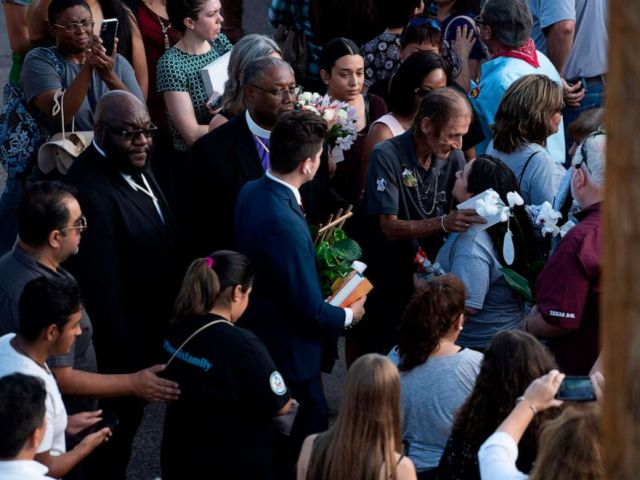 PHOTO: Antonio Basco, husband of El Paso Walmart shooting victim Margie Reckard, greets attendees during his wifes visitiation service outside La Paz Faith Center in El Paso, Texas, on Friday, Aug. 16, 2019.