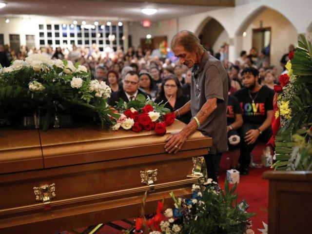 PHOTO: Antonio Basco, whose wife Margie Reckard was murdered during a shooting at a Walmart store, stands next to her coffin at a visitation service to which he had invited the public in El Paso, Texas, on Friday, Aug. 16, 2019.