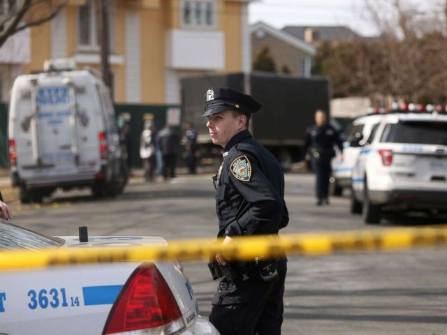 PHOTO: Police stand near where reputed mob boss Francesco Franky Boy Cali lived and was gunned down, March 14, 2019, in Staten Island, New York.