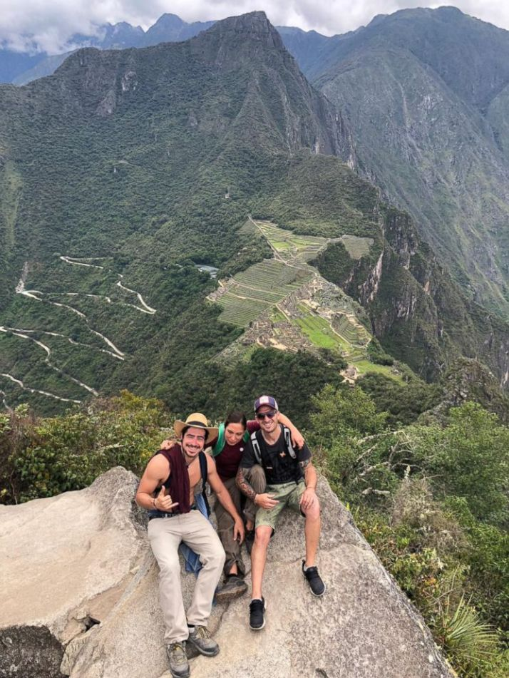 PHOTO: Carla Valpeoz, a partially blind traveler who has gone missing in Peru, poses for a photo with two men on a peak overlooking Machu Picchu in southern Peru.