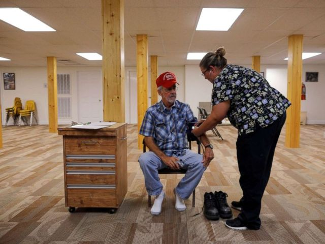 PHOTO: Nurse Melissa Muse checks the blood pressure of retired coal miner James Marcum, who has complicated black lung disease, during an exam at Stone Mountain Health Services in St. Charles, Va., May 18, 2018.