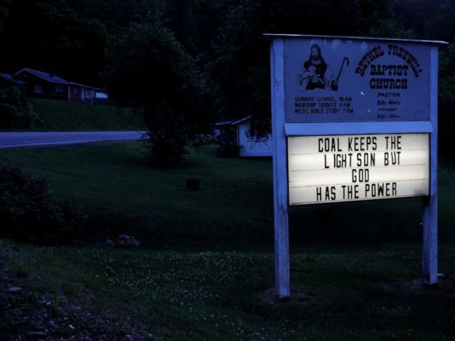 PHOTO: The sign outside the Bethel Freewill Baptist Church reads Coal Keeps the Lights On But God Has the Power in Virgie, Ky., May 18, 2018.