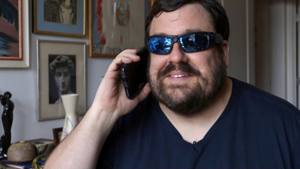 Dan Bell demonstrates how he uses undercover glasses to film in malls.