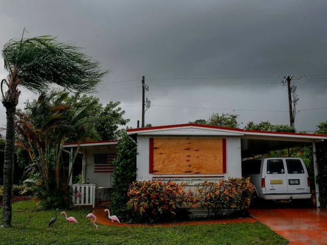 PHOTO: A van is parked near a home in the Tropical Acres Mobile Home Park, an area that is under mandatory evacuation with Hurricane Dorian off the coast of Florida, in Jensen Beach, Fla., Sept. 2, 2019.