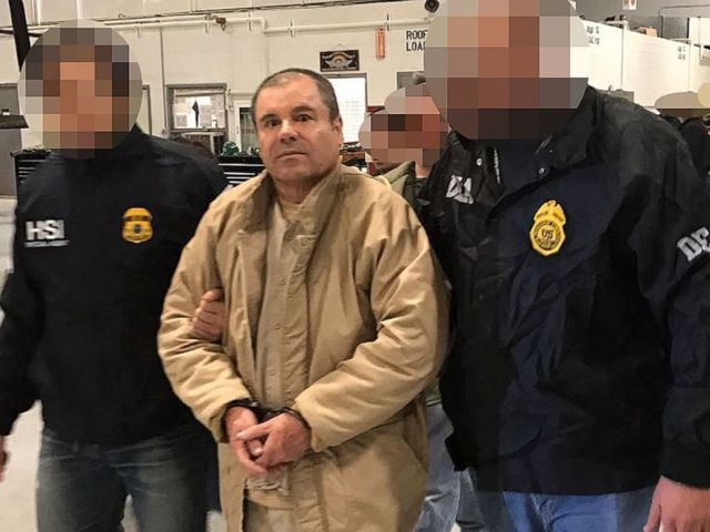 PHOTO: Joaquin Guzman Loera aka El Chapo Guzman (C) is escorted in Ciudad Juarez by the Mexican police as he is extradited to the United States.