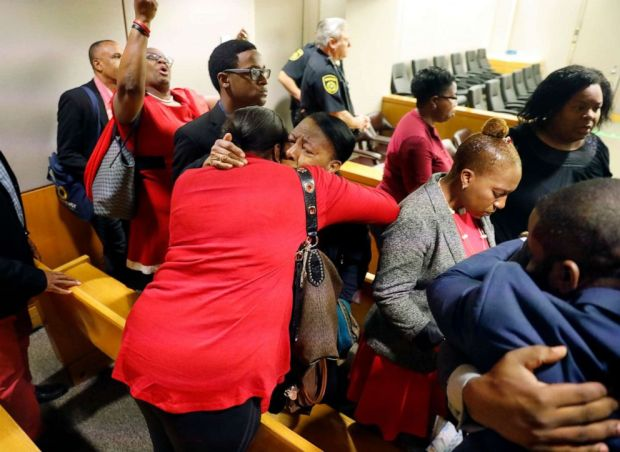 PHOTO: Members of Botham Jeans family embrace in the courtroom after fired Dallas police Officer Amber Guyger was found guilty of murder, Oct. 1, 2019, in Dallas.
