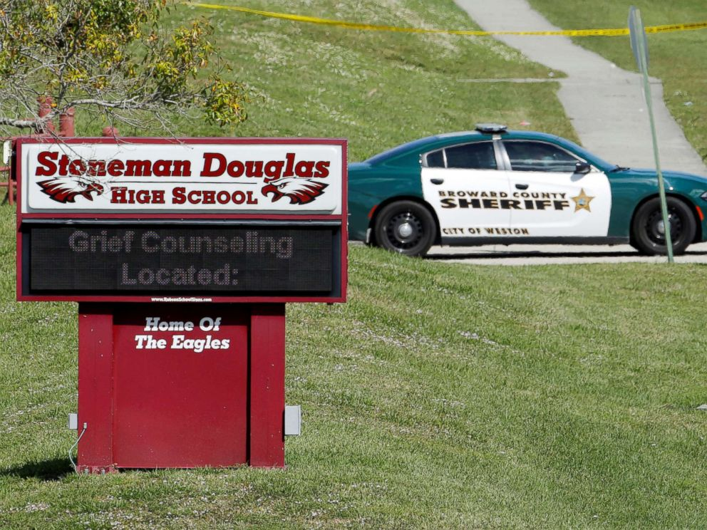 PHOTO: A message about grief counseling appears on the electronic signboard at Marjory Stoneman Douglas High School one day after a shooting at the school left 17 dead in Parkland, Fla. Feb. 15, 2018.