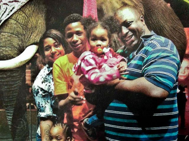 PHOTO: In this undated family file photo provided by the National Action Network, Eric Garner, right, poses with his children during a family outing.
