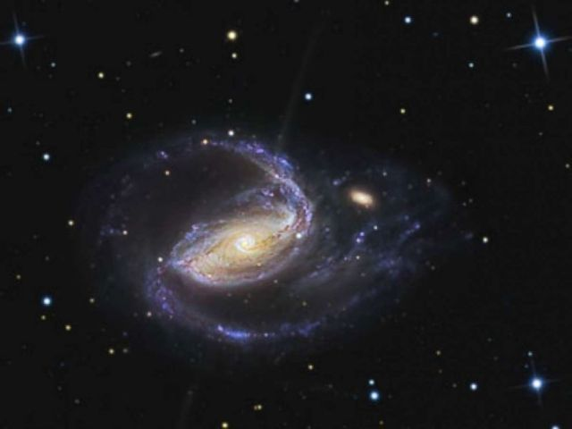 NGC 1097 is a barred spiral galaxy, or blackhole, in the constellation Fornax.