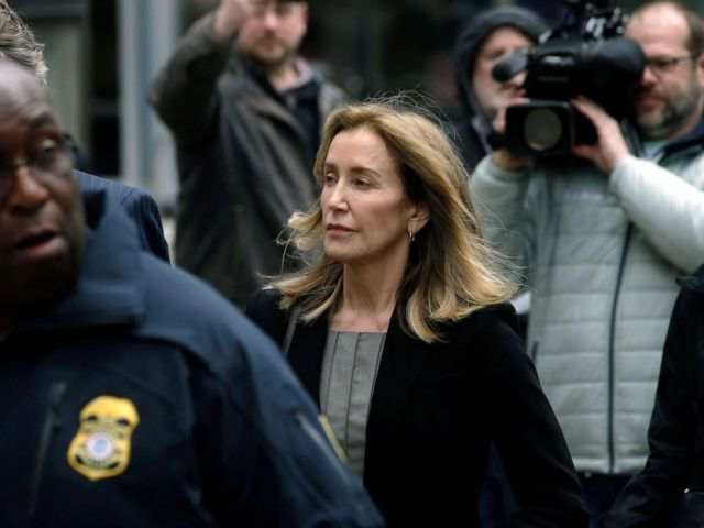 PHOTO:Felicity Huffman arrives at federal court, May 13, 2019, in Boston, where she is scheduled to plead guilty to charges in a nationwide college admissions bribery scandal.