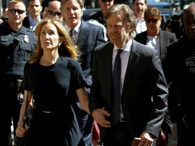 PHOTO: Actress Felicity Huffman arrives at the federal courthouse with her husband William H. Macy, before being sentenced in connection with a nationwide college admissions cheating scheme in Boston, Massachusetts, Sept. 13, 2019.