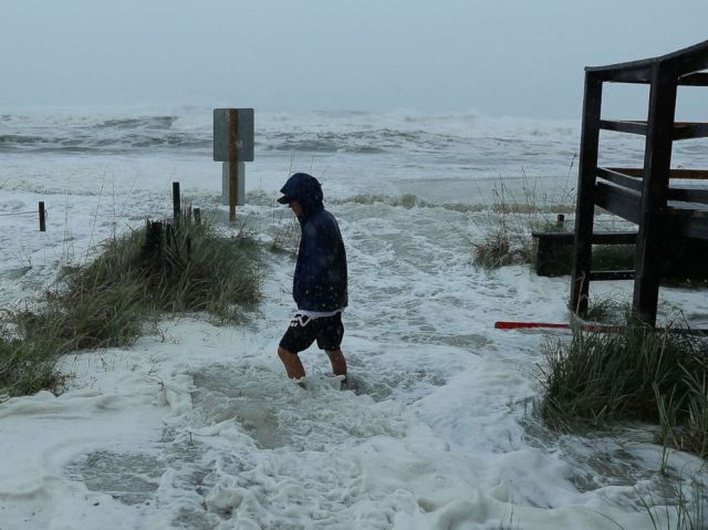 PHOTO: Cameron Sadowski walks along where waves are crashing onto the beach as the outer bands of hurricane Michael arrive, Oct. 10, 2018 in Panama City Beach, Fla.