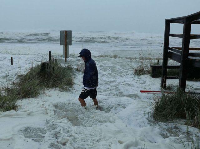 PHOTO: Cameron Sadowski walks along where waves are crashing onto the beach as the outer bands of hurricane Michael arrive, Oct. 10, 2018 in Panama City Beach, Fla.