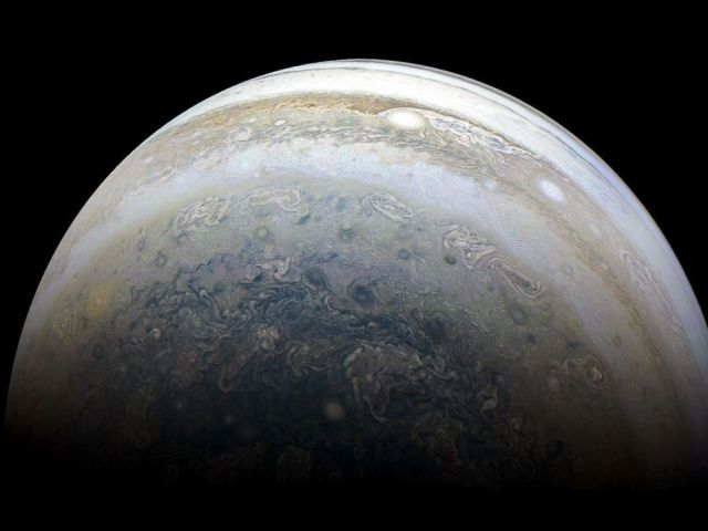 PHOTO: Jupiters southern hemisphere is pictured by NASAs Juno spacecraft on the outbound leg of a close flyby of the gas-giant planet in an image released on July 2, 2018.
