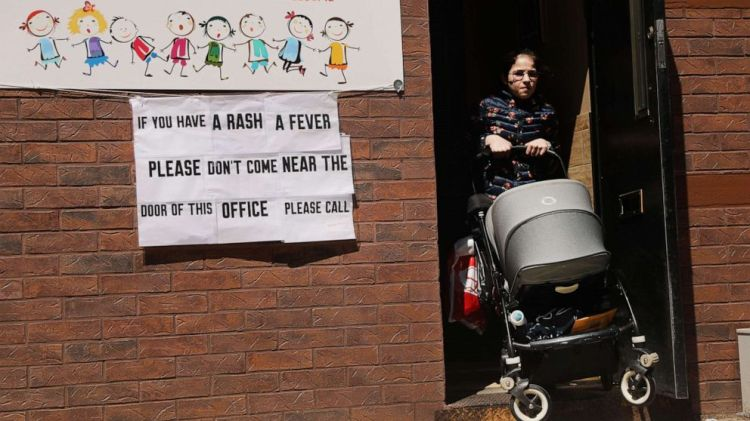 A sign warns people of measles in the ultra-Orthodox Jewish community in Williamsburg on April 10, 2019 in New York.