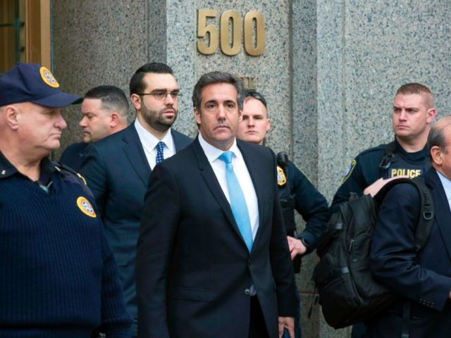 PHOTO: In this April 16, 2018, photo, Michael Cohen, center, leaves federal court in New York.