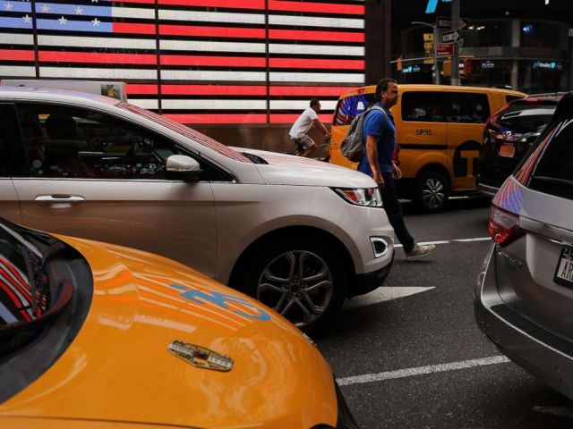 PHOTO: A man walks through traffic in Times Square on July 30, 2018, in New York.
