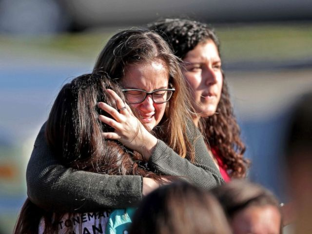 PHOTO: Students released from a lockdown embrace following a shooting at Marjory Stoneman Douglas High School in Parkland, Fla., Feb. 14, 2018.