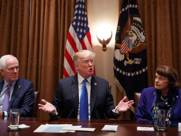 PHOTO: Sen. John Cornyn, left and Sen. Dianne Feinstein, right listen to President Donald Trump speak during a bipartisan round-table discussion on gun control, at the White House, Feb. 28, 2018.