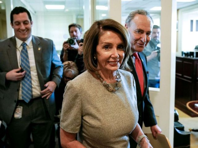 PHOTO: Speaker of the House Nancy Pelosi and Senate Minority Leader Chuck Schumer walk together after President Donald Trump announced a deal to end the partial government shutdown on Capitol Hill in Washington, Jan. 25, 2019.