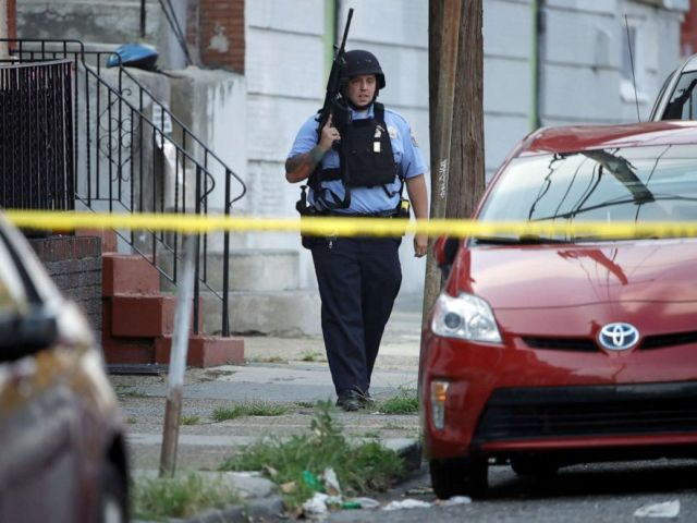 PHOTO: A police officer patrols the block near a house as they investigate an active shooting situation, Aug. 14, 2019, in the Nicetown neighborhood of Philadelphia.