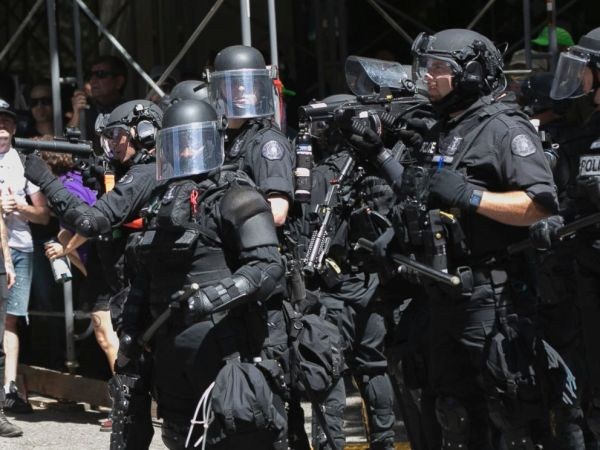 Protesters clash with police, each other in dueling ...