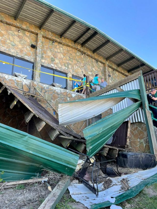 PHOTO: Investigators with Hamilton County, TN Office of Emergency Management & Homeland Security survey the collapse of a deck at Zoi's Restaurant in Harbor Lights Marina in Soddy-Daisy, Tenn., May 1, 2021.