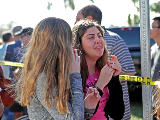 PHOTO: Students released from a lockdown are overcome with emotion following following a shooting at Marjory Stoneman Douglas High School in Parkland, Fla., Feb. 14, 2018.