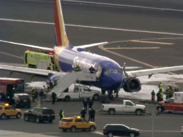 PHOTO: A Southwest Airlines plane on the tarmac at the airport in Philadelphia after making an emergency landing, April 17, 2018.