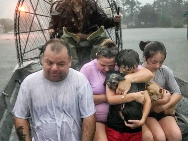 PHOTO: In this photo provided by the Texas Parks & Wildlife Department, a family is rescued via fan boat by a member of the department from the flood waters of Tropical Depression Imelda near Beaumont, Texas, Sept. 19, 2019.