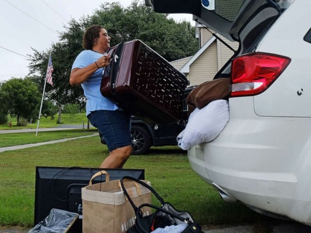 PHOTO: Patra Parker packs up her car to leave her home in Plaquemines Parish, La., in advance of Tropical Storm Barry, on July 11, 2019.