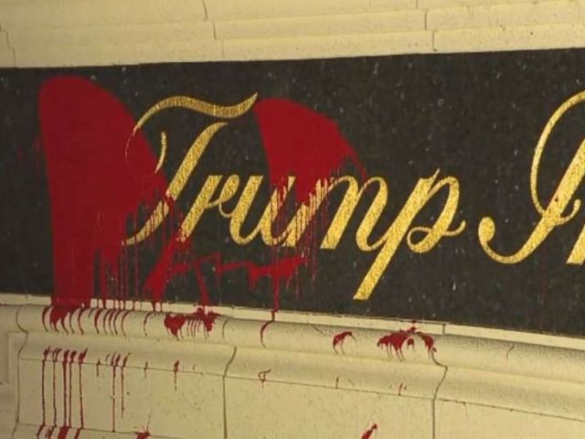 Red paint became splattered on the entrance ticket at Trump Worldwide Golf Membership in West Palm Seaside, Florida, on Saturday, March 31, 2018.