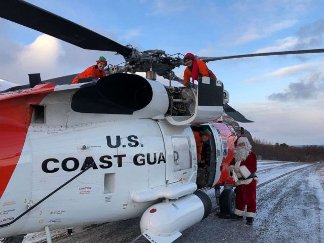PHOTO: A Coast Guard Air Station Kodiak MH-60 Jayhawk helicopter aircrew delivers Santa, his elves and gifts to the children of various remote villages in Alaska, Dec. 12, 2018.