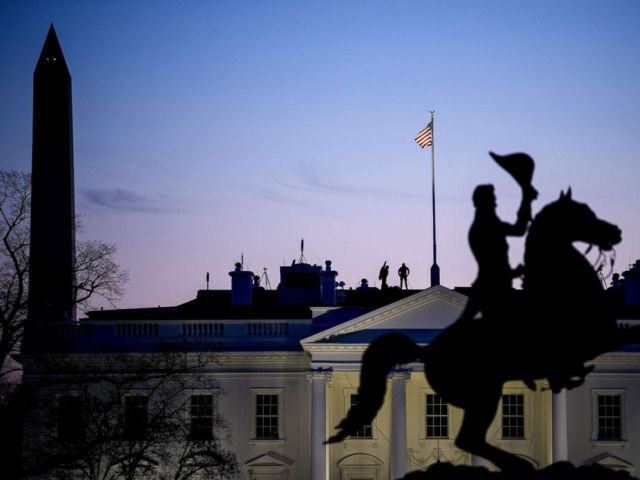 PHOTO: Secret Service counter snipers are seen on the roof of the White House, Jan. 11, 2019, in Washington.