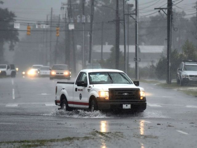 PHOTO: A vehicle with the Wilmington Fire Department drives through a flooded street from Florence, now a tropical storm in Wilmington, N.C., Saturday, Sept. 15, 2018.