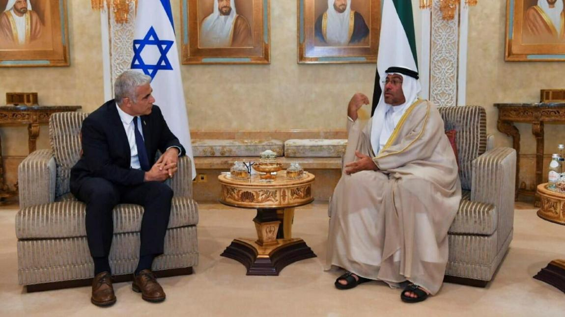 Israeli Foreign Minister Yair Lapid sits next to United Arab Emirates Minister of State Ahmed Ali Al Sayegh during their meeting in Abu Dhabi, United Arab Emirates, on June 29, 2021
